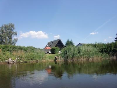 Ferienhaus Bollmann vom Bade- und Angelsee aus