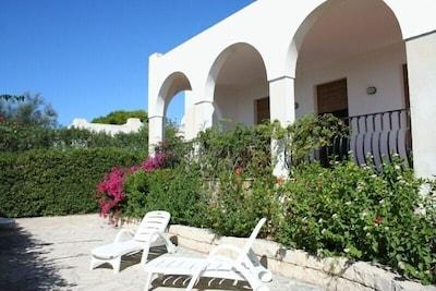 Veranda, garden to the sea