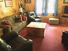Comfy living room furniture. Sleeper sofa. 3 leather recliners.