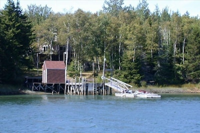 View from boat of dock and property