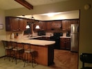 Kitchen -- fully stocked! Overlooks the lake.