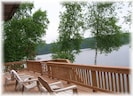 Huge deck overlooking lake.  Stairs to patio below.  Safety gate with latch.