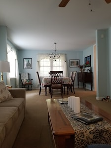 Newly interior painted spacious, comfortable living room,  large dining table