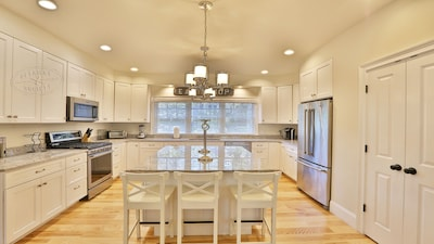 Spacious kitchen with island and plenty of sunlight!
