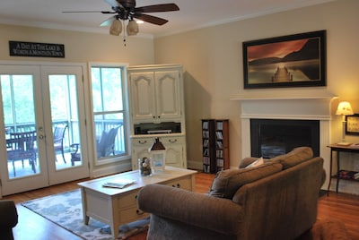 Comfortable, spacious living room with home theatre for movies and music.
