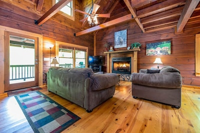 Family Room with Gas Fireplace and access to Deck and River.
