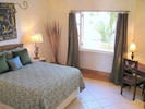 Master bedroom with large walk-in closet and attached bath which is fully tiled
