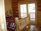 All bedrooms lead out to the lakeside deck