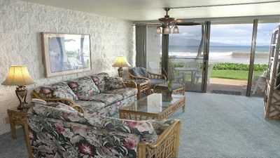 Old photo shows amazing views. Carpet & fabrics on sofas & chairs are updated.