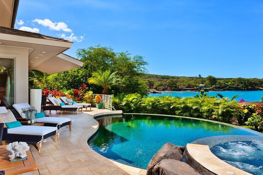 This Maui rental home features a terrace with pool and ocean views
