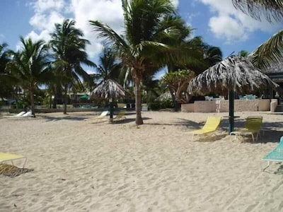 Private Beach at Gentle Winds with shade or not