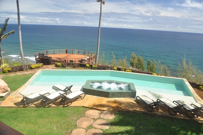 The back yard with everything - pool, hot tub, and deck - with huge ocean views
