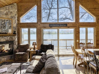 The huge great room welcomes you with direct views of the lake.