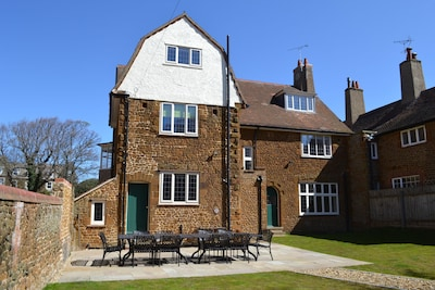 Rear of the house with enclosed garden and patio.