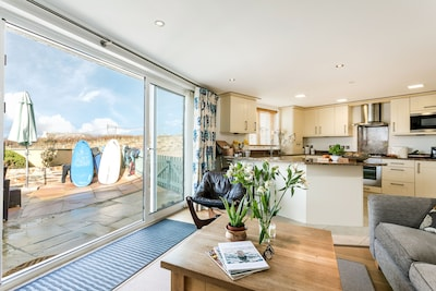 Looking out onto the terrace from the open plan living at Puffins
