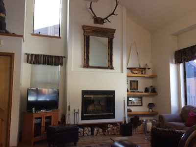 Fireplace and vaulted ceiling in the living room