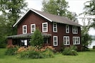 The Cottage from the back and side; large grassy yard is great for family games!
