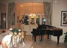 Open dining and living room with Baby Grand piano