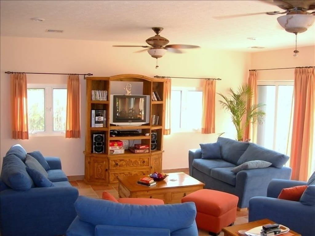 Spacious living room for group entertaining or intimate evenings at home.