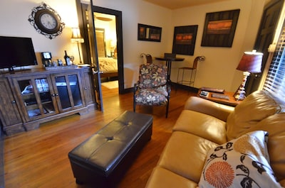 Living area includes leather sleeper sofa, mini fridge, DVD player and Wi-Fi
