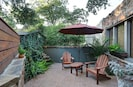 Relax with a glass of wine in your private patio