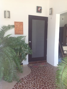 Secure, lighted and gated entry area from street