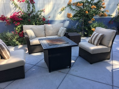 Just walk out the door to comfy outdoor seating surrounded by privacy fence.