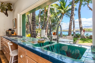 One of a kind kitchen and outdoor dining area looks out on Sunny Kohala Coast
