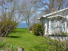 Front of the house, side yard and lake as seen from the parking area.