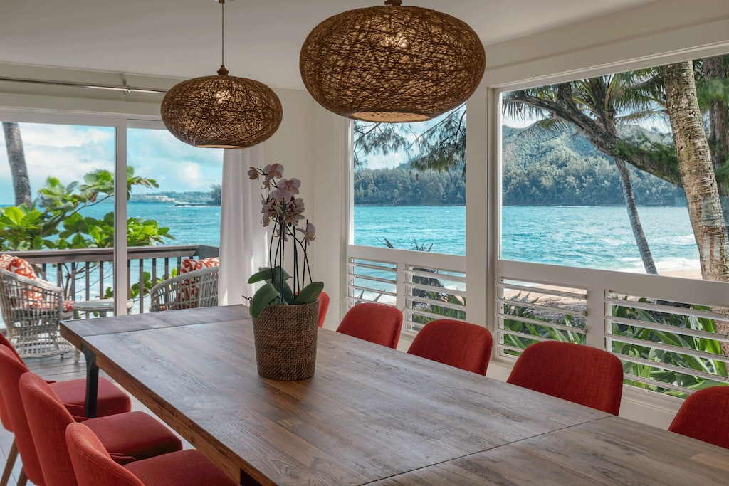 Dining area of a vacation rental in Hawaii overlooking a bay
