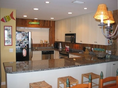 View of kitchen/bar from dining area