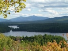 Top of Crusher Mt looking down at Loon Lake. Great hike for anyone. Whiteface in the background.
