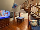 living room w/ 65 in smart TV & pool table
