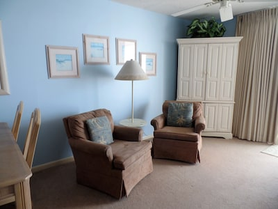 Swivel rockers add to TV viewing pleasure. Blue and tan color scheme  give beach