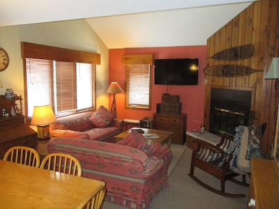 Main upper level living room. HDTV and wood burning fireplace