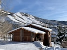 In the winter, enjoy this snow-covered beauty as your mountain home