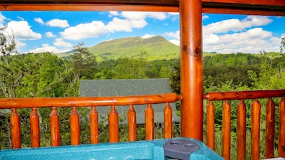 Relax and enjoy the spectacular view of Bluff Mountain from the hot tub!
