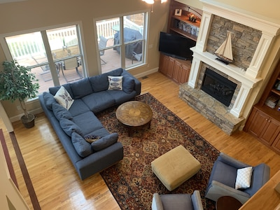 Vaulted two-story living room with gas fireplace