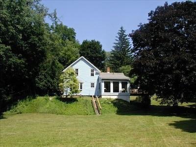 Fenced backyard down to stream