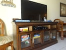50 inch flat screen TV with a large selection of CD movies, games and books