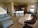 living / dining with queen size sleeper sofa that sleeps 2 adults.