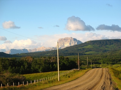 The 2 mile road to Payne Lake Lodge. Old Chief Mountain welcomes you home.