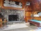 MOOSE HOUSE fireplace, pool table and edge of corner bar