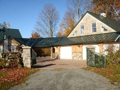 Front of secluded rental with carport.