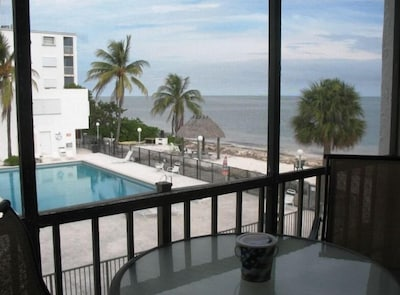 Balcony view of pool and ocean