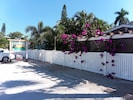 Property is fully fenced. Bougainvillea at pergola. Two parking spaces per unit.