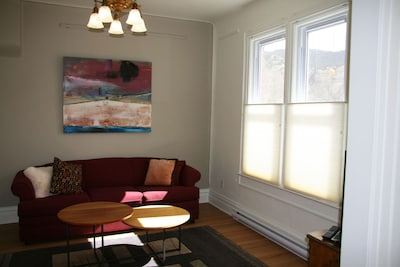 One of 2 front parlors with new, comfortable convertible sofa