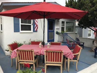 Outdoor dining, lighted umbrella, ocean breezes