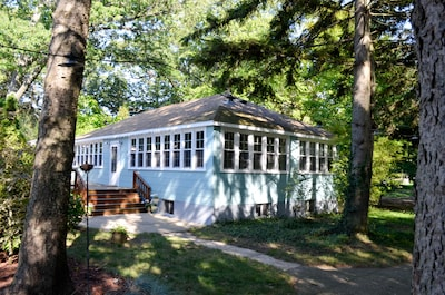 Tucked in among mature pines on Lake Michigan is a community of Vintage Cottages