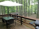 Barbecue surrounded by tall trees! Outdoor dining set seats 6.